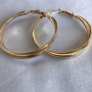 Gold tone three strand hoop earrings